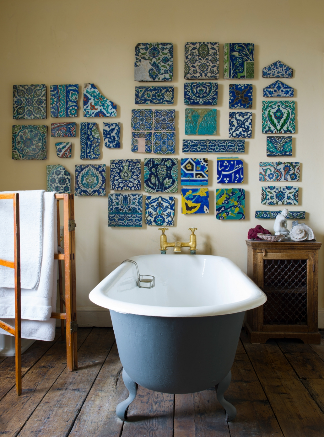 An elegant Georgian bathroom, decorated with a collection of elaborate, turquoise antique tiles from the Ottoman Empire.