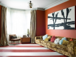 'Nothing in this house has really been bought new, it is more of a challenge and much more fun that everything has a story.' The stripy Forbo vinyl flooring comes in a range of colours. Cushions from P&B can be seen on the vintage 1970s eBay sofa alongside the mid-century chair and cabinet.