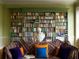 Classical Georgian green paint highlights a library of well thumbed books, whilst a cast of Admiral Nelson takes centre stage.